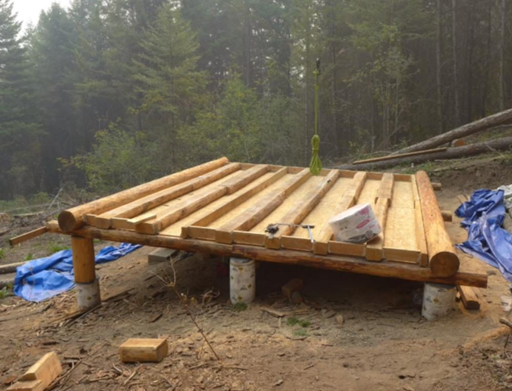 off grid log cabin build floor construction